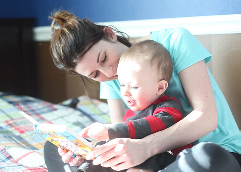 Author Becky Thompson reading with her son